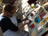 Anna preparing her hand made paper with pigments to create rich surface for drawing and painting.