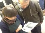 Martyn and Christina looking at print