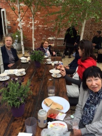 Enjoying cream teas in the courtyard